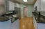 Kitchen - gorgeous granite counters, Kitchen Aid refrigerator, neutral white cabinets