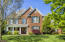 Charming All Brick Home sited on large, level half acre site features Master on Main and 3 BRS Up plus Bonus and Optional 5th BR/Playroom/Flex Space