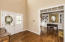 Double French Doors welcome you to Spacious Foyer with Gleaming Hardwood and three piece crown molding