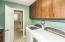 Just off the Master Bath and close to the Kitchen, this is the ideal spot for the laundry room.