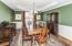 Wainscot molding, octangular trey ceiling and gleaming hardwood