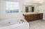 Whirlpool tub and walk in shower- Adjoins Laundry Room for easy access