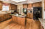 Custom Mouser Hickory Cinnamon Cabinets and sparkling granite