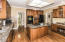 Large island with 5 burner gas cooktop and Double Ovens