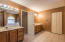 Master ensuite featuring His and Her large vanities