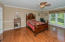 Main level master suite with gleaming hardwoods