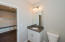 Full main level bath with tub/shower combo, granite counter tops, tile flooring