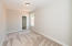 Main level bedroom/office with spacious walk-in closet