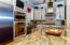 Kitchen with Custom Cabinetry and Huge Granite Island