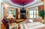 Living Area with Tray ceiling and Stone Fireplace