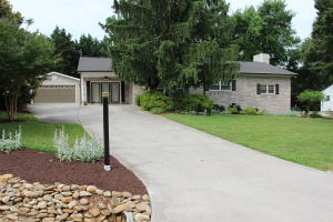 905 Olive Rd offers amazing curb appeal and ample parking