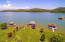 A very level lot and unobstructed Lake Views make this a Premiere Tellico Village Location!