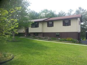 Raised Ranch with 2 car garage. 4 bedrooms and 3 baths!