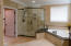 Master Bath with glass shower and soaker tub