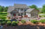 Rear View of Main Home: Stone Patios, Professional Landscaping!