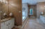 Master Bath with 2 Vanities, Jetted Tub, Tiled Walk-in Shower, Tile Floor, Granite Tops!