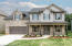 """Welcome Home! The """"Willow"""" features brick and stone accents with barn shutters and timber porch post"""