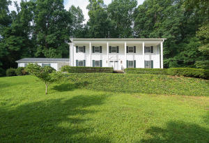 Grand stately home in beautiful, wooded setting!