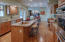 Large eat-in kitchen with center island, gas cooktop, and double ovens