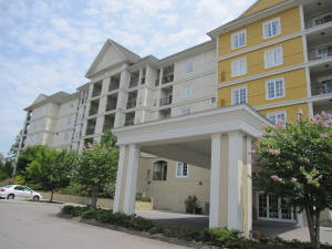 Great and fully furnished condo on an active overnight rental program in the Resort of Governor's Crossing, close to outlet shopping malls, restaurants, wineries, Dollywood and much more. Resort amenities include indoor and outdoor water parks, pirate playground, children's pool, mini-golf, arcade rooms, trampoline, exercise and meeting room. Fully equipped Kitchen, bathroom w/whirlpool tub, private balcony off from spacious bedroom with 2 Queen-sized beds, looking at Bluff Mountain and beautiful sunsets. Can lease from $89 to $219 a night depending on the time of year. $37,000 gross revenue for 2017! HOA includes all utilities and amenities. Buyer to verify square footage. Have a super vacation at the Resort, collect rental income and have the best of both worlds!