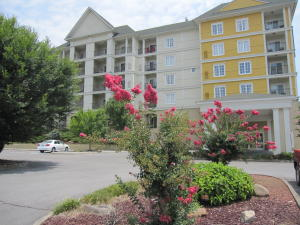 Fantastic and full furnished condo on an active overnight rental program in the Resort of Governor's Crossing, close to outlet shopping malls, restaurants, wineries, Dollywood and much more. Resort amenities include indoor and outdoor water parks, pirate playground, children's pool, mini-golf, arcade rooms, trampoline, exercise and meeting room. Fully equipped Kitchen, bathroom w/whirlpool tub, private balcony off from spacious bedroom with 2 Queen-sized beds, looking at Bluff Mountain and beautiful sunsets. Can lease from $89 to $219 a night depending on the time of year. $38,000 gross revenue for 2017! HOA includes all utilities and amenities. Buyer to verify square footage. Have a super vacation at the Resort,collect rental income and have the best of both worlds!