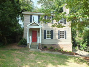 Updated and nestled on wooded cul de sac!