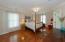 Spacious Master Bedroom Hardwood Floors