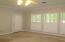 Master Bedroom with Plantation Shutters. Access to Screened Porch