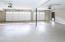 Spacious 3 car garage has epoxy floor coating