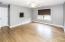 Bedroom 2 has hardwood floor, ceiling fan & walk-in closet