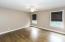 Bedroom 4 has wood floor, ceiling fan and walk-in closet