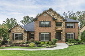 Stunning 2 Story Brick & Stone home with Main Level Master Suite & full finished walk out basement