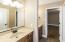 Full Bath separates Bedrooms 3 and 4. It has dual vanities, wood cabinets & tile floor