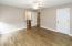 Bedroom 3 has wood floor, ceiling fan & walk-in closet