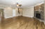 A wooden staircase located off of Family Room leads to 4 Bedrooms & Bonus Room