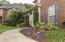 Beautifully landscaped! Flowering Gardenias, Azaleas, lilies, a specimen Japanese Maple, and a white Crepe Myrtle!