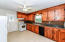 Kitchen with Knotty Pine Cabinets and Tin Backsplash