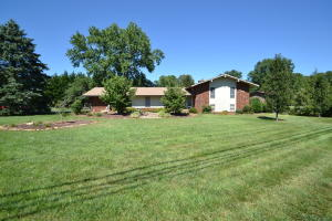 Updated 2413 Sq.Ft. 4 BR 3 Bath brick & vinyl split level home on over .60 acre level lot in Gulf Park S/D with remodeled baths, kitchen & tons of Hwd floors!