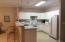 Kitchen w/bar open to LR