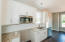 SS appliances, granite countertops, beautiful cabinetry w/crown molding