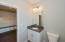 Downstairs full bath features tile floors, granite countertops, and shower/tub combo