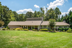 Welcome home to a Lifestyle of living on Turtle Point Lane. Two acres of heavily landscaped property with lake cove access and a fishing dock.