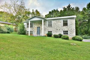 BRICK FRONT HOME WITH FENCED TREE LINED BACKYARD