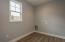 Laundry room w/stylish wood-look tile flooring