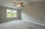 Master suite with vaulted ceiling