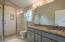 Elegant master ensuite, tile walk-in shower, granite countertops, tile flooring