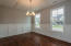 Formal dining with modern craftsman moldings