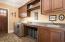 Custom Cabinets, Sink, Closet, Ironing board, door to side yard.