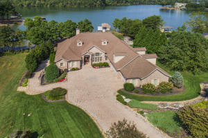 Turn-Key Lakefront Home includes most Furnishings & Vacant Lakefront Lot Next Door.