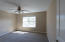 Good sized bedroom upstairs with ceiling fan.